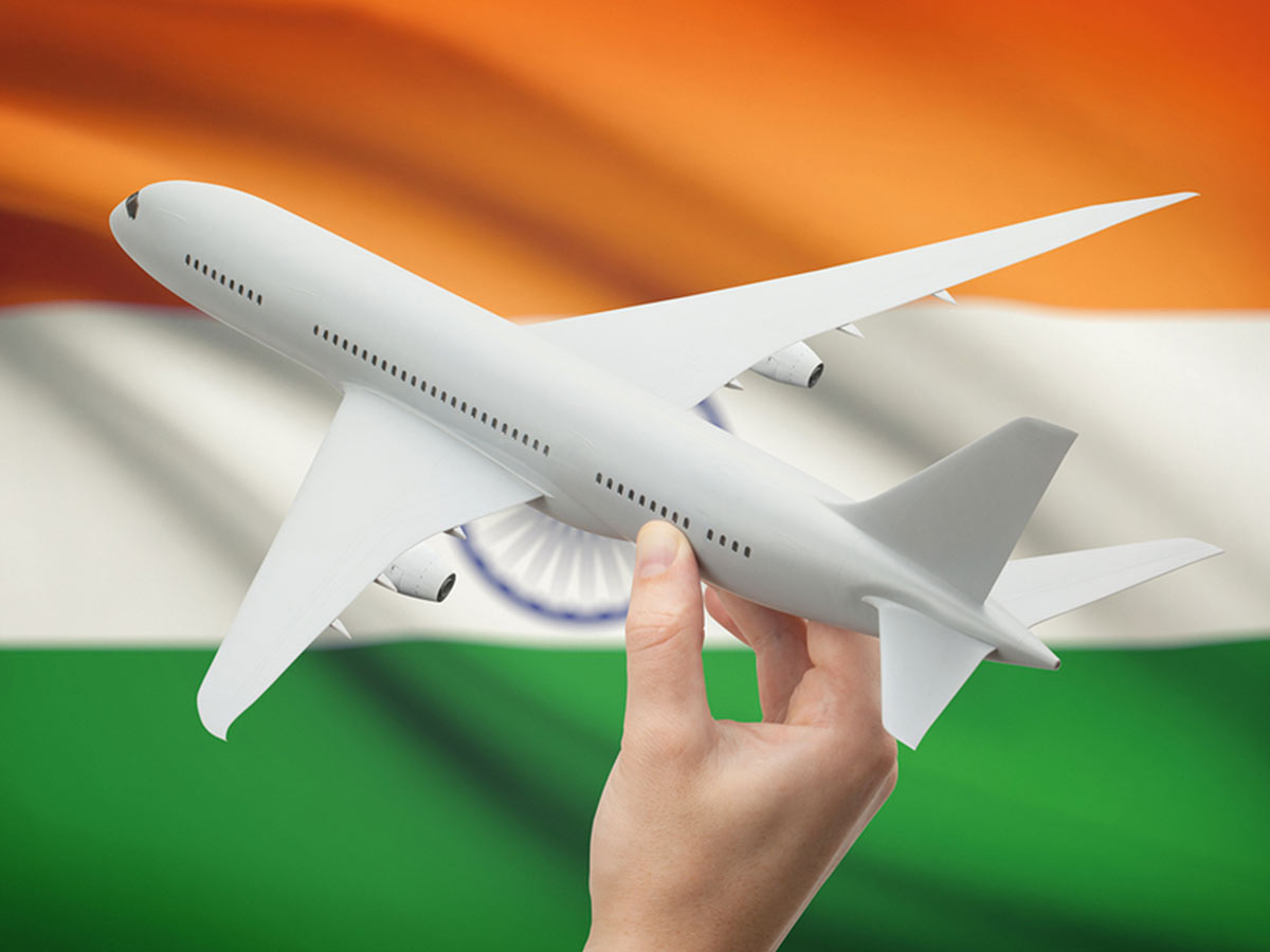 Handheld toy plane in front of Indian flag