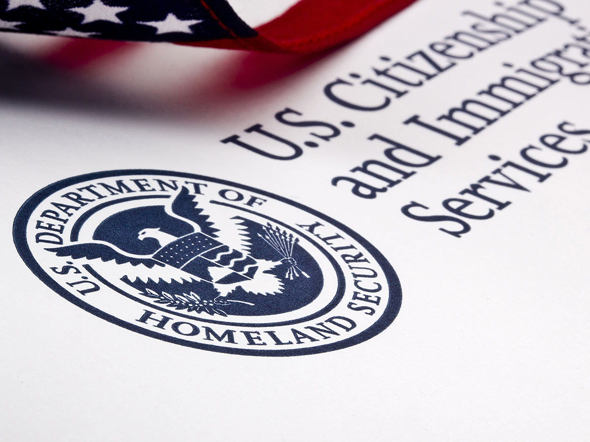 A close up of immigration paperwork from the USCIS