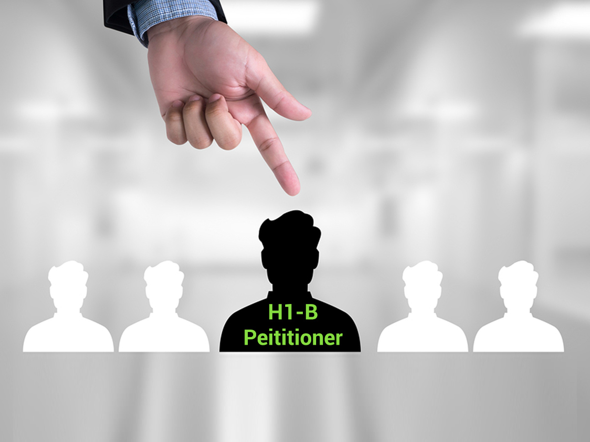 Finger pointing to a petitioner in H1B lottery, depicting selection
