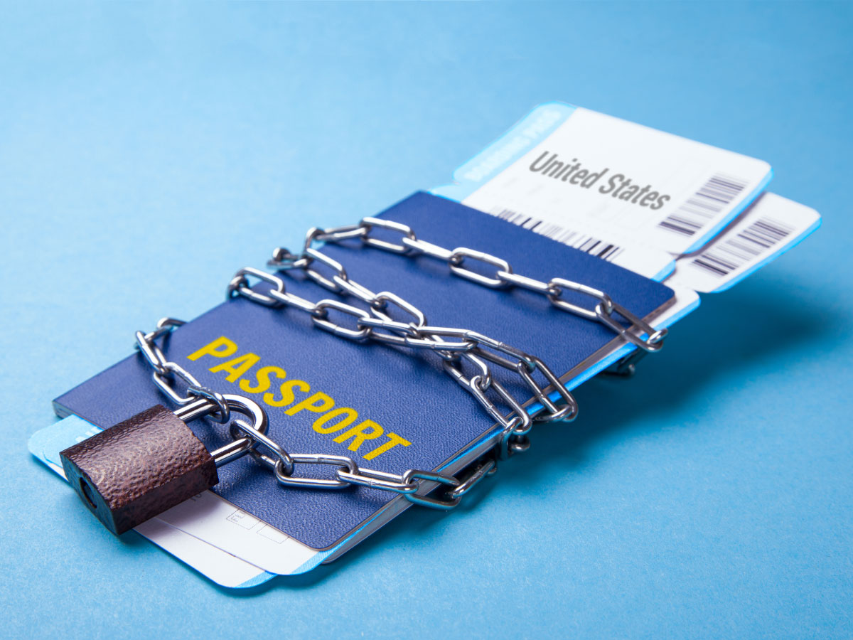A chained/locked passport indicating travel ban