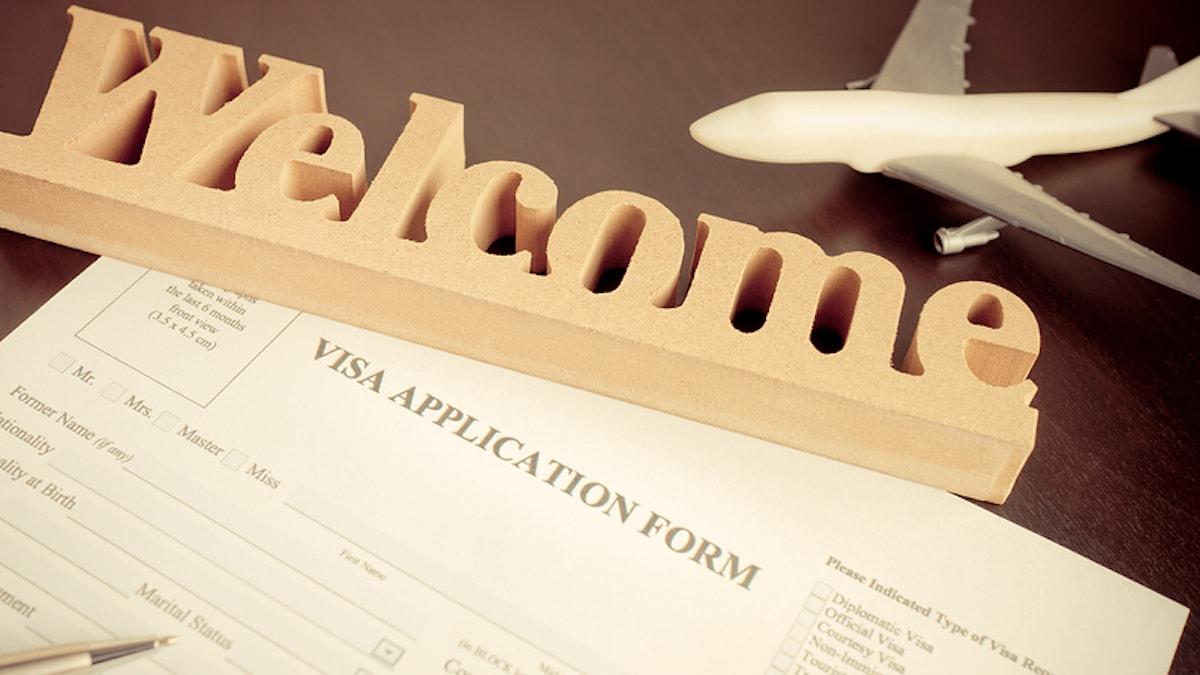 Visa application showing a welcome sign reflecting how the new immigration reform is beneficial for work visa holders.
